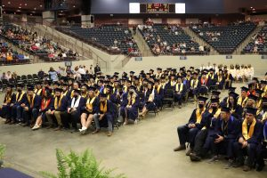 Knox Central seniors seated in front of the stage at graduation.