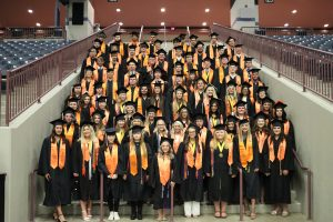Lynn Camp seniors pose for a group photo inside The Arena prior to graduation.