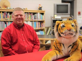 Clint Mays shown with a tiger in the library at Girdler Elementary
