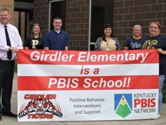 Girdler PBIS team display banner outside of school.